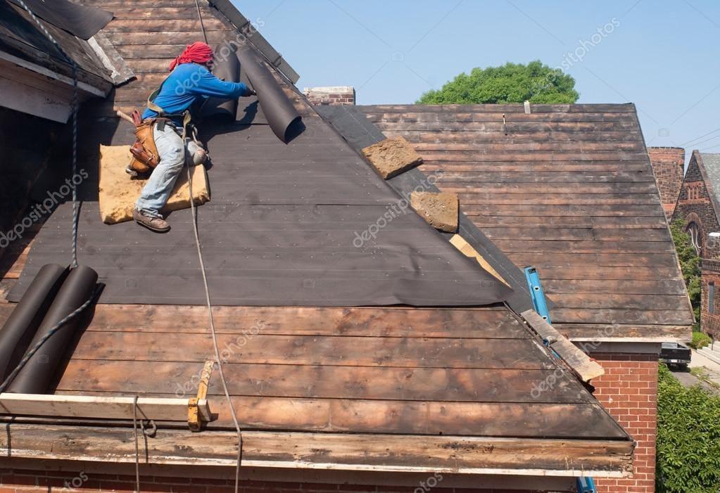roofer installing roofing tar