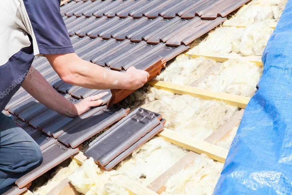 roofer installing new shingles