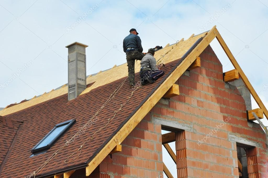 two roofers on home