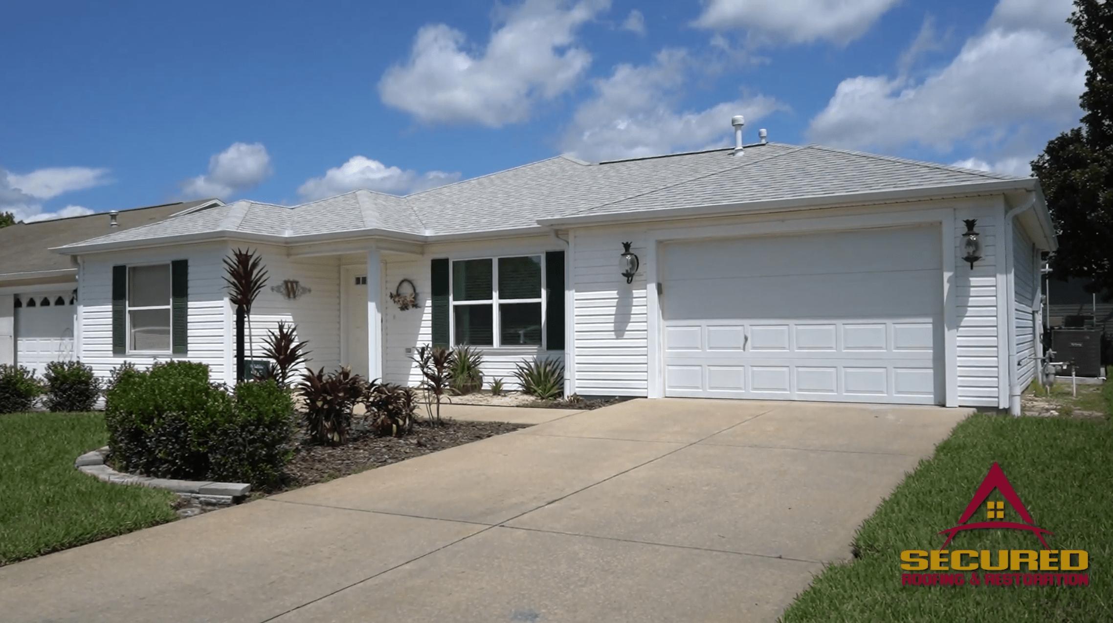 white home in residential neighborhood
