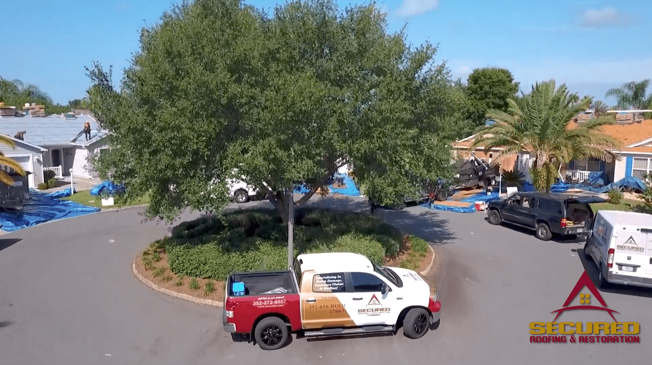 secured roofing and restoration company truck in neighborhood