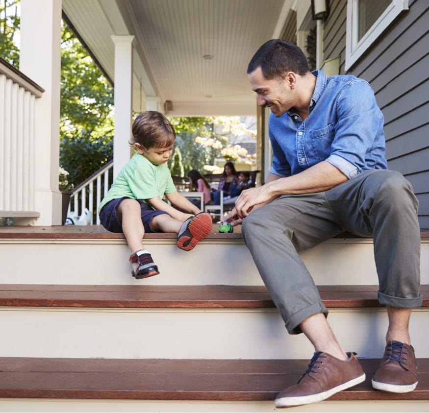 father and son sitting on porch