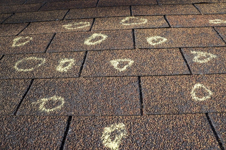 Hail damage on roof shingles marked up by chalk to show where damage took place; hail damage roof guide