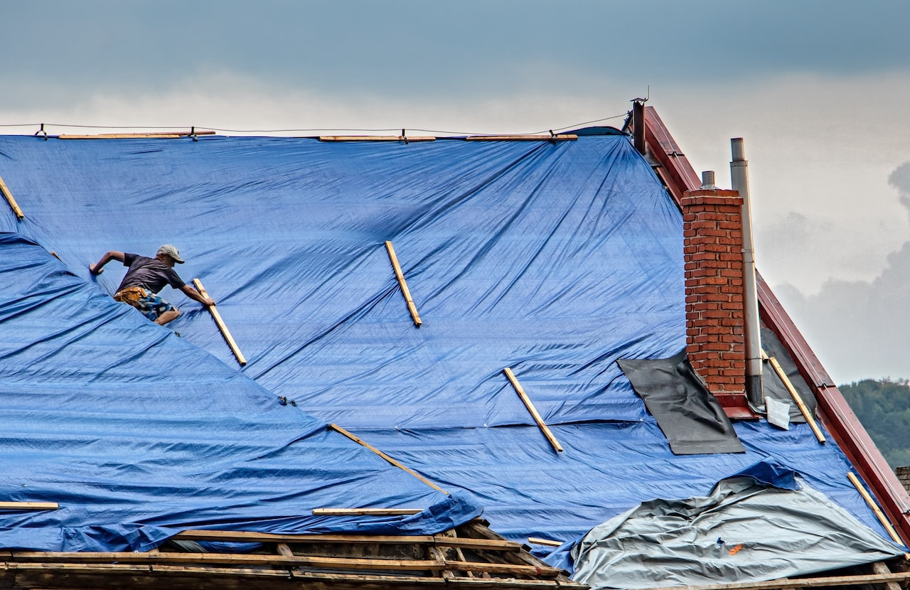 tarp covers the roof of house