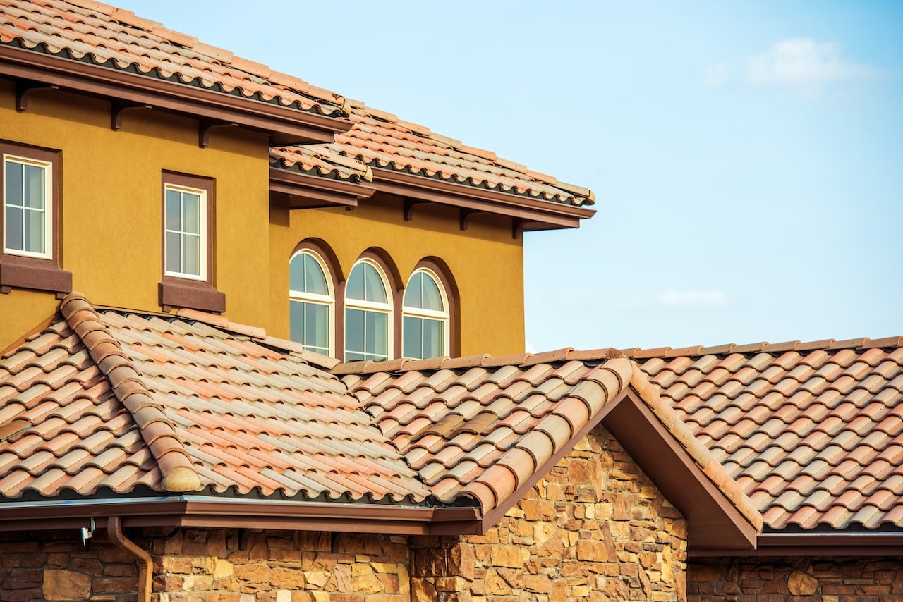 south west style home with tile roofing