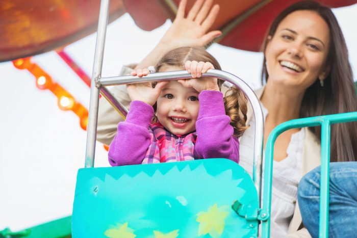 little girl with mother at theme parks in orlando